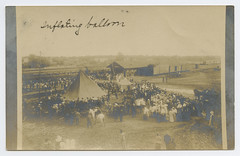 Inflating balloon (SMU Central University Libraries) Tags: texas hotairballoons crowds railroadcars railroadstations depots rppc