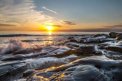 Sunset sur Audresselles (daumy) Tags: sunset sky france jaune rouge bleu reflet ciel cote vague plage rocher couleur couchdesoleil audresselles nikonflickraward nordpasdecalaispicardie