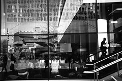 Inside Outside (Places, Faces) Tags: street city uk people urban blackandwhite bw streets detail reflection glass monochrome architecture composition buildings reflections photography mono shadows britain candid centre central perspective streetphotography silhouettes streetscene compo streetphoto framing peoplewatching urbanstreets robmchale