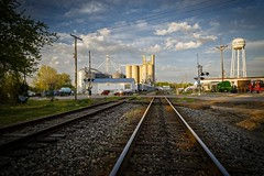 Salisbury Tracks II (Notley) Tags: railroad sky clouds spring watertower tracks silo april salisbury silos grainelevator railroadtracks grainelevators 2016 10thavenue notley charitoncounty ruralphotography notleyhawkins missouriphotography httpwwwnotleyhawkinscom notleyhawkinsphotography salisburymissouri