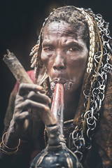 Nadato, an old Surma woman (Cyril Blanchard) Tags: voyage africa old travel portrait people woman black vertical blackbackground smoke traditional shell smoking tribes omovalley tradition ethiopia ethnic afrique tribu nomade nomadic omo äthiopien etiopia ethiopie traditionalclothing etiopía onewomanonly nomades africantradition foreignpeople portraitformat africanpeople エチオピア africanethnicity ethnie indigenousculture andjou etiópia kibish פיה nomadicpeople traditionallifestyle эфиопия interestinglook valléedelomo اثيوبيا onefemaleonly tribuafricaine omotribe indigeneousculture אתיו vallã©edelomo traditionafricaine ethniedafrique ethniesdafriques vêtementstraditionnelsafricains portraitdetributraditionnel portraitdelavalléedelomo portraitsdelavalléedelomo omovalleyportrait omovalleyexpedition omovalleyreportage reportagesurlavalléedelomo expeditionsurlavalléedelomo personnesnomades personnenomade
