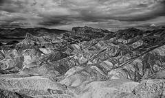 Manly Beacon, Zabriskie Point (f0rbe5) Tags: california ca bw usa mountain texture film monochrome rock landscape lava nationalpark scenery rocks ae1 1996 erosion ash deathvalley badlands zabriskiepoint tilted ridges rockformation conglomerates weathering volcanicash deathvalleynationalpark colourcontrasts siltstone sediments mudstone manlybeacon borates convolutions amargosarange breathtakinglandscapes ashfalls williamlmanly furnacecreekformation sedimentarydeposits badlandridges