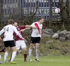 Grit and determination on the face of Alan Vezza as he clears the danger (Stevie Doogan) Tags: park west scotland scottish first super juniors division league holm clydebank bole maybole bankies mcbookiecom