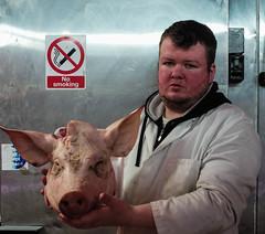 pig and butcher L1007553 (rafhuggins) Tags: leica england london pig head butcher brixton 240
