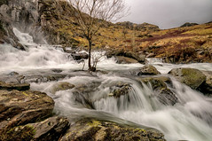 Fast and furious (einir.leigh) Tags: uk trees winter orange snow mountains color colour water wales walking landscape flow outdoors waterfall nikon women stream britain cymru welsh snowdonia northwales ogwen ogwenvalley