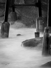 B+W Catherine Hill Bay Pier (laith_stevens) Tags: old longexposure blackandwhite pier movement rocks industrial waves structure catherinehillbay smokywater