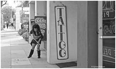 That's right, UNDER the rug. Tattoo Parlour in Anaheim (Sylvie Poitevin (Orange Vintage Photography)) Tags: california orange girl tattoo anaheim streetsweeper