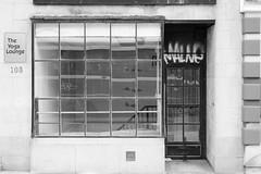 Malne/The Yoga Studio (L_) Tags: blackandwhite bw toronto shop store storefront queenstreet shopfront queenstreeteast topw501