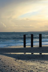 Three (Jim-Paterson) Tags: sunset sea sky clouds landscape evening coast dorset poles groyne bournemouth