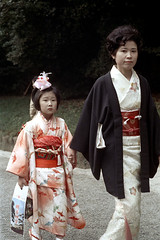 31-120 (ndpa / s. lundeen, archivist) Tags: city flowers winter portrait people woman color fall film girl face japan 35mm japanese tokyo clothing child path candid traditional nick shibuya daughter mother citylife clothes walkway kimono 1970s visitors 1972 31 youngwoman motherandchild pathway motheranddaughter meijishrine dewolf honshu traditionalclothing flowersinherhair nickdewolf photographbynickdewolf reel31