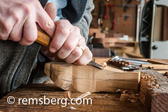 Hands using a tool to carve wood in a studio in Pennsylvania. (Remsberg Photos) Tags: wood usa art studio hands artist pennsylvania working craft tools indoors carver oneperson skill stahlstown