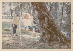 Little girl being pushed on a swing (simpleinsomnia) Tags: old playing color tree vintage found outside antique snapshot daughter mother swing photograph vernacular foundphotograph
