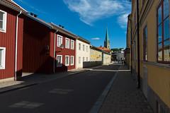 Hunnebergsgatan (Housemill) Tags: street shadow lumix shadows cathedral outdoor bluesky panasonic gata pointandshoot sverige linkping domkyrkan stadsmilj skuggor blhimmel lx5