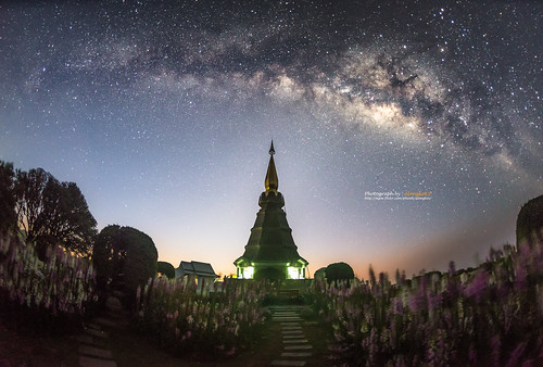 Milky way on night sky with pagoda on the top of Inthanon mountain, Chiang Mai, Thailand.