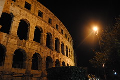 Coliseum (modestmoze) Tags: old city travel trees windows sky brown black green history yellow metal architecture night dark outside outdoors shadows croatia pole coliseum bushes atnight lightpole archs pula