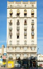 Peeking out (ep_jhu) Tags: parque windows man building argentina lines architecture buenosaires fuji ar repetition balconies fujifilm ba arg santelmo bsas balcones lezama ciudadautnomadebuenosaires x100s