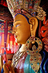 Maitreya Buddha..... Thiksay Monastery (pallab seth) Tags: city travel panorama india mountain tourism statue landscape asia tour monastery valley idol layers leh himalayas deity thikse highaltitude gompa jammuandkashmir indusvalley maitreyabuddha thiksay thikseygompa