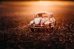 Warm Sunset (Gabriela Tulian) Tags: road light sunset summer sky orange sun sunlight plant nature beautiful car toy warm view sundown dusk vibrant horizon transport scenic sunny nobody flare vehicle summertime headlight backlit atmospheric endofday miniaturecar