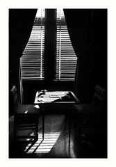 Empty Chair (Joe Franklin Photography) Tags: blackandwhite bw abstract window contrast chair highcontrast duotone joefranklin almostanything wwwjoefranklinphotographycom