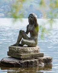 Seejungfrau in Bad Wiessee (bayernphoto) Tags: schnee sun art statue bayern bavaria weide wasser bokeh kunst bad nackt grn alpen frau bergsee sonne metall stein gruen tegernsee fruehling glitzern unschaerfe wiessee frisches seejungfrau