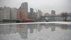 slow lane (Paul J's) Tags: nyc usa newyork reflection eastriver barge queensborobridge rooseveltisland 13011025nyc rtc61