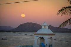 A full moon rising over Playa San Francisco; San Carlos, Mexico.