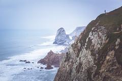 Vastness (www.nomomentophotos.com) Tags: seascape man portugal fog haze rocks cape vastness