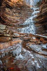 Winter Cathedral (reflectioninapool) Tags: winter light brown white snow mountains color texture ice water vertical stone creek outdoors frozen waterfall rocks stream day falls westvirginia freeze rectangle icicles appalachia lowangle route60 gauleybridge canebranch