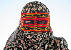 a bandari woman wearing the traditional mask called the burqa on a market, Hormozgan, Bandar Abbas, Iran (Eric Lafforgue) Tags: portrait people woman horizontal outdoors persian clothing asia veil mask iran market muslim islam religion hijab persia headshot hidden covered iranian bazaar adults adultsonly oneperson islamic burqa ethnicity middleeastern frontview persiangulf sunni bandarabbas burka chador balouch hormozgan onewomanonly lookingatcamera burqua   embroidering 1people  iro straitofhormuz  colourpicture  borqe boregheh iran034i1834