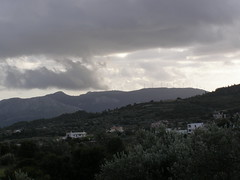 (Psinthos.Net) Tags: trees houses winter sky cloud mountain mountains nature clouds forest countryside afternoon village cloudy hills fields february treebranches shrubs pinetrees olivetrees windturbines cloudiness olivegroves       psinthos                       psinthosvillage