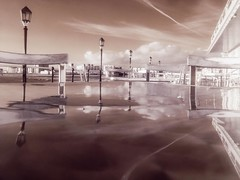 Reflection (4foot2) Tags: reflection wet water lamp rain table pier worthing seaside chair westsussex olympus lamppost infrared seafront worthingpier olympusc5060 highpass redfilter 2016 r72 infraredfilter hoyar72 lowpass highpassfilter metaltable digitalinfraredphotography deepredfilter lowpassfilter 4foot2 4foot2flickr 4foot2photostream fourfoottwo