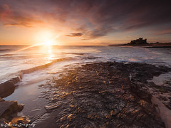 Bamburgh Sunrise (Photography by Chris Gregory) Tags: seascape sunrise dawn bamburghcastle canonef1740mml leefilters canon5dmkii