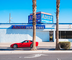 adult superstore (miemo) Tags: street travel red sky usa car facade store spring downtown lasvegas nevada olympus palm palmtree storefront thestrip minimalism asphalt sportscar omd adultstore olympus1240mmf28 em5mkii