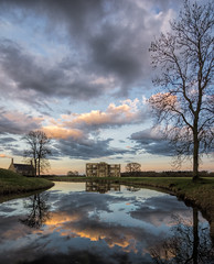 Lyveden reflected (grbush) Tags: england sky lake reflection tree water architecture clouds landscape northamptonshire nationaltrust goldenhour lyvedennewbield tokinaatx116prodxaf1116mmf28 sonyslta77
