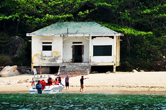 Nobody home (Roving I) Tags: sea abandoned tourism islands bush tourists vietnam beaches pointing whitesand lifejackets danang derelictbuildings speedboats outboardmotors