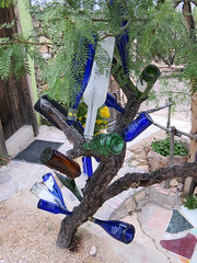 Tree with bottles, La Posada Milagro. (dckellyphoto) Tags: tree glass tile interesting whimsy texas desert bottles dry clear terlingua whimsical decorated 2016 laposadamilagro