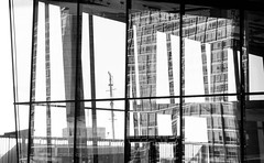 Jazz Mann BW (stephenbryan825) Tags: reflection glass triangles liverpool buildings graphic angles abstracts mannisland