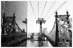 Between Scylla and Charybdis (agruebl) Tags: nyc newyorkcity blackandwhite newyork reflection manhattan eastriver schwarzweiss spiegelung queensborobridge poma rooseveltislandtram luftseilbahn