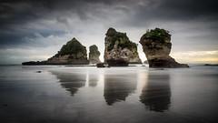 Motukiekie reflections (loveexploring) Tags: longexposure sea newzealand seascape reflection beach rock landscape island coast cloudy motionblur southisland tasmansea westcoast seashore rockformation movingwater dramaticscenery motukiekie