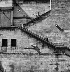 Climbing Wall - London by Simon & His Camera (Simon & His Camera) Tags: city people urban blackandwhite bw building london texture monochrome lines wall architecture stairs composition contrast outdoor simonandhiscamera