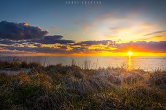 sunset in lomma (dannygreyton) Tags: bridge sunset sky color beach grass clouds colorful sweden malmoe malm malmo resund resundsbron lomma