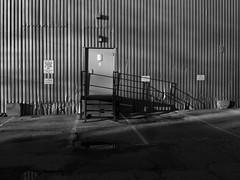 Metal Wall (geowelch) Tags: toronto blackwhite parkdale urbanlandscape urbanfragments olympusomdem5 panasoniclumixvario1445mm
