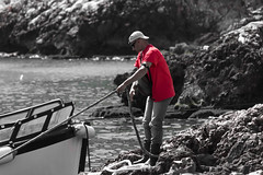 Levanzo boatman (kurjuz) Tags: red sea italy rock boat mediterranean sicily ropes sicilia egadi levanzo