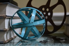 Without Gears.... (Little Hand Images) Tags: glass lace orb books gears reel filmreel shallowdof bookedges flatgears tealblueorb wireorb