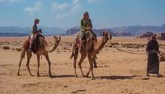 Pleasures of desert (Igor Sorokin) Tags: travel mountains clouds walking sand nikon rocks shadows view desert wadirum scenic middleeast tourists jordan riding arab 1855 camels jordanian distant riders d40x