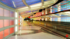 Sky's the Limit (Mark Kaletka) Tags: travel light sculpture chicago color architecture us illinois airport neon unitedstates united relaxing terminal ohare walkway travelers