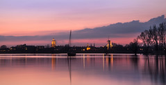 The sunset skyline of Gorinchem (marielledevalk) Tags: longexposure pink trees sunset sky holland reflection church water windmill dutch rose skyline clouds landscape boat europe colorfull thenetherlands