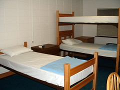 Beds. (dccradio) Tags: clock minnesota wall bed beds room stpaul sheets pillow blanket bunkbed northwestern saintpaul mn accommodations dormroom alarmclock nightstand radioconference inspo2004 skylightradionetwork hartillhall