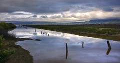 Cloud play over Alviso (PeterThoeny) Tags: california longexposure sky cloud reflection water clouds bay pond track raw day cloudy outdoor dusk perspective sanjose amtrak saltpond siliconvalley sanfranciscobay straight alviso slough traintrack waterreflection photomatix fav200 1xp alvisomarinacountypark nex6 selp1650
