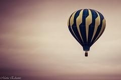Flying (MacaPDX) Tags: pink blue sky yellow fly flying balloon hotairballoon woodburn tulipfestivalwoodburn